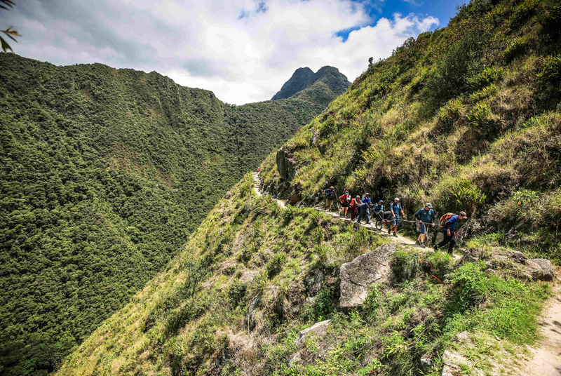 Image: group of people climbing Inca Trail